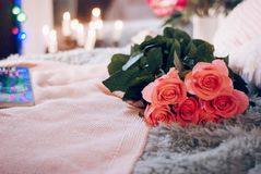 A bunch of pink roses on the bed. A surprise Valentine`s Day in bed, soft color tone Stock Image