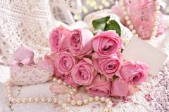 Bunch of pink roses with blank card Stock Photography