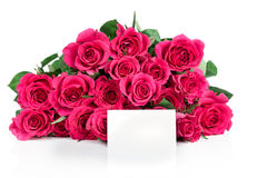 Bunch of pink roses and a greeting card Stock Photos