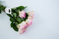 Bunch of pink roses with happy mothers day tag Stock Photography
