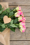 Bunch of pink roses with heart shape tag Stock Photo
