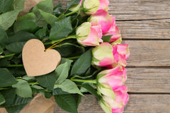 Bunch of pink roses with heart shape tag Stock Image