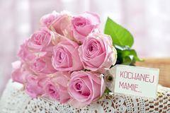 Bunch of pink roses for Mother Day Day in Poland with text -for. Beautiful bunch of pink roses for Mother`s Day with text written in polish language on paper Stock Images