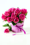 Bunch of pink roses in pink vase copy space background. Pink roses on white background selective focus Royalty Free Stock Image