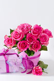 Bunch of pink roses in pink vase and gift box copy space backgro Royalty Free Stock Photography