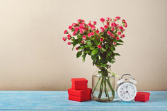 Bunch of pink roses and present Stock Images