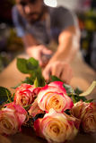 Bunch of pink roses on table Stock Image
