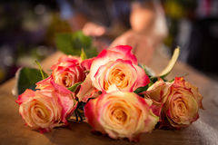 Bunch of pink roses on table Royalty Free Stock Photos