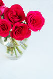 Bunch of pink roses in a vase. On light background Stock Images