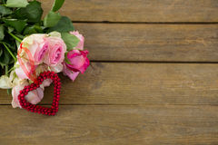 Bunch of pink roses on wooden plank Royalty Free Stock Images