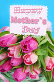 Bunch of pink tulips and  card for mom Stock Photography