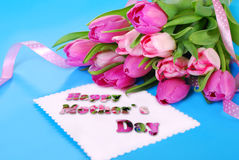 Bunch of pink tulips and card for mom Royalty Free Stock Photography