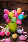 Bunch of pink tulips and colorful easter eggs Royalty Free Stock Photography