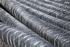 Bunch of pipes for insulation. Perspective Royalty Free Stock Image
