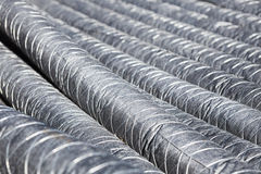 Bunch of pipes for insulation. Perspective Stock Photos