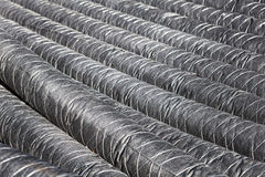 Bunch of pipes for insulation. Perspective Stock Image