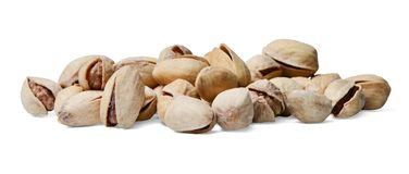 A bunch of pistachios scattered in a chaotic manner on a white isolated background. stock photos