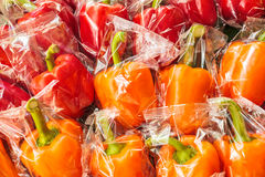 Bunch of plastic wrapped bell peppers Stock Photography