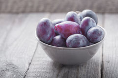 Bunch of Plums on a wooden table.  Stock Photo