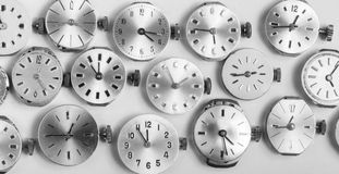Bunch of pocket watch clockworks in black and white Stock Photo