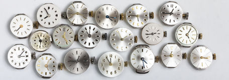 Bunch of pocket watch clockworks in a row Stock Photo