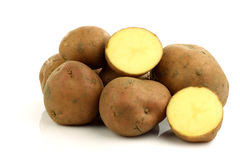 Bunch of potatoes and a cut one Royalty Free Stock Photo