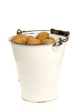 Bunch of potatoes in an old enamel bucket Royalty Free Stock Photography