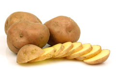 Bunch of potatoes and a sliced one Royalty Free Stock Photography