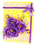 Bunch of purple flowers on yellow. Bunch of purple flowers with lace on yellow Royalty Free Stock Image