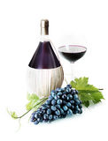 Bunch of purple grapes with wine Stock Photo