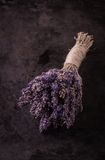 Bunch of purple lavender flower on black tray. Vertical photo with single bunch of lavender flower bonded by natural cord with vintage mood. Purple blooms are Stock Images