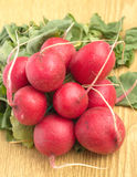 Bunch of radish on brown desk Royalty Free Stock Image