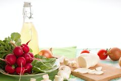 Bunch of radishes on spinach leaves with slovak cheese Stock Images