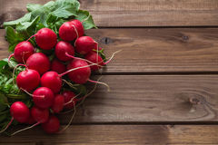 A bunch of radishes on a wooden table. View of the  bunch of radishes on a wooden table Royalty Free Stock Images
