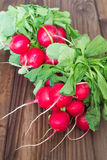 A bunch of radishes on a wooden table. View of the  bunch of radishes on a wooden table Royalty Free Stock Photography