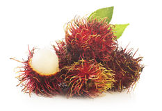 Bunch of rambutan isolated on white background. Bunch of rambutan with leaves  isolated on white background Royalty Free Stock Photography