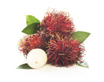 Bunch of rambutan isolated on white background. Bunch of rambutan with leaves  isolated on white background Stock Photography