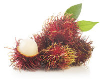 Bunch of rambutan isolated on white background. Bunch of rambutan with leaves  isolated on white background Royalty Free Stock Images