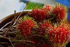 Bunch of ripe fresh rambutan stock photos