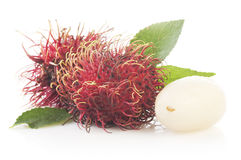 Bunch of rambutan  on white background. Bunch of rambutan with leaves   on white background Stock Images
