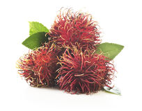 Bunch of rambutan  on white background. Bunch of rambutan with leaves   on white background Stock Photography