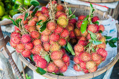 Bunch of rambutan in the wicker basket on the Vietnamese market Royalty Free Stock Photography