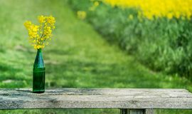 Bouquet with on a wooden outdoor table royalty free stock photography