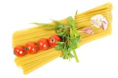 Bunch of raw apaghetti with garlic and tomato Stock Photos