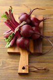 Bunch of raw beetroots on wood. Food close-up Stock Image