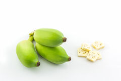 Bunch of raw green bananas and Banana slices. Stock Photography