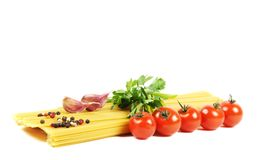 Bunch of raw spaghetti with tomato Stock Photos