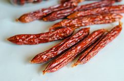 Smoked salami on a light background. Selective soft focus. Close-up royalty free stock photos