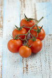 Bunch of red cherry tomatoes Stock Photos