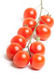 Bunch of Red Cherry Tomatoes on White Background Royalty Free Stock Image